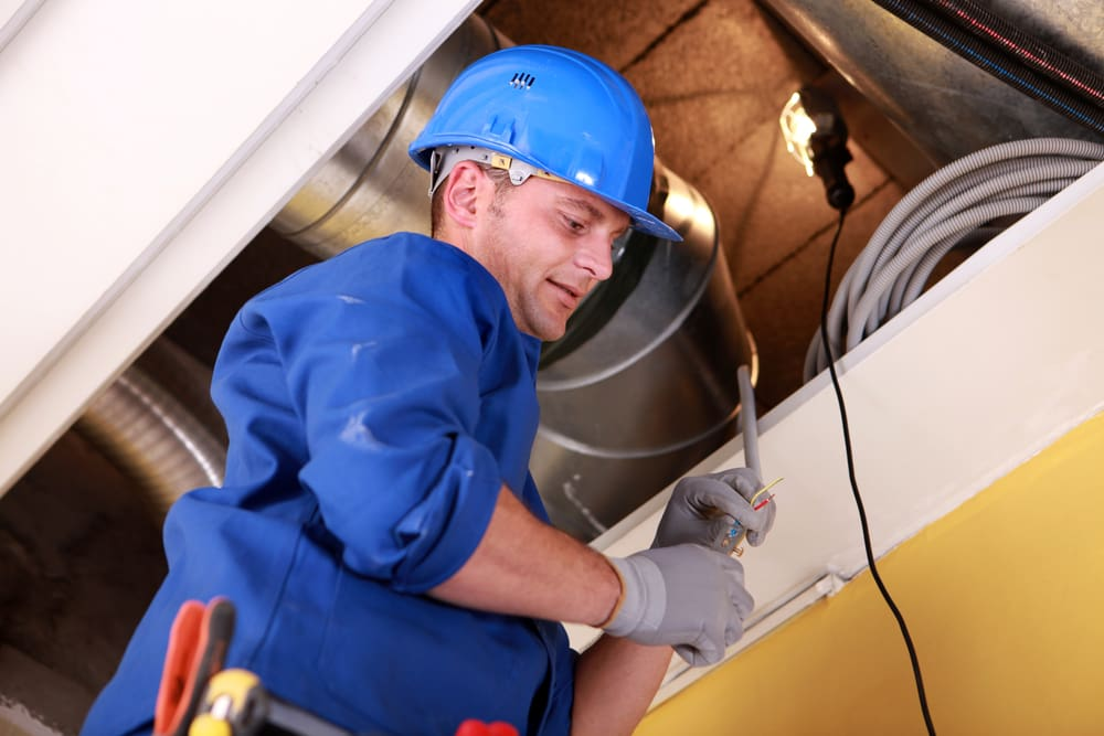 man inspecting hvac for mold